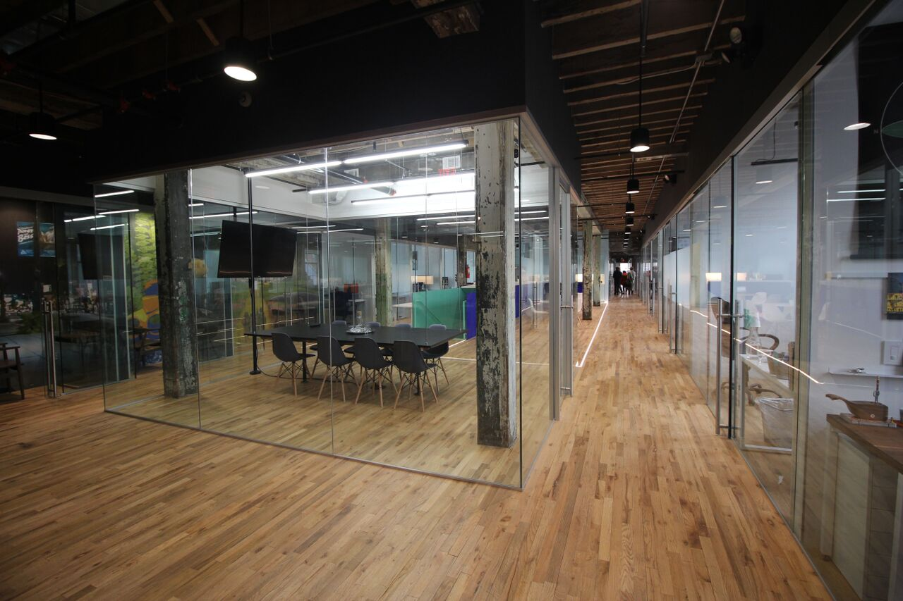Glass-fronted conference room and offices