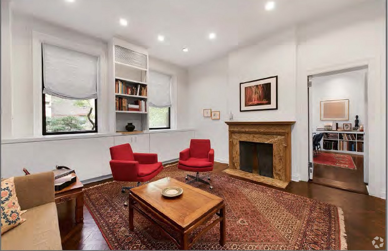 Open area with fireplace and oriental rug