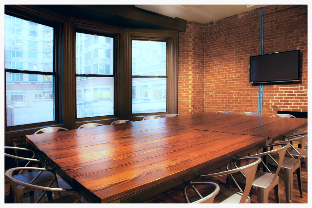 Conference room with wood table and chairs
