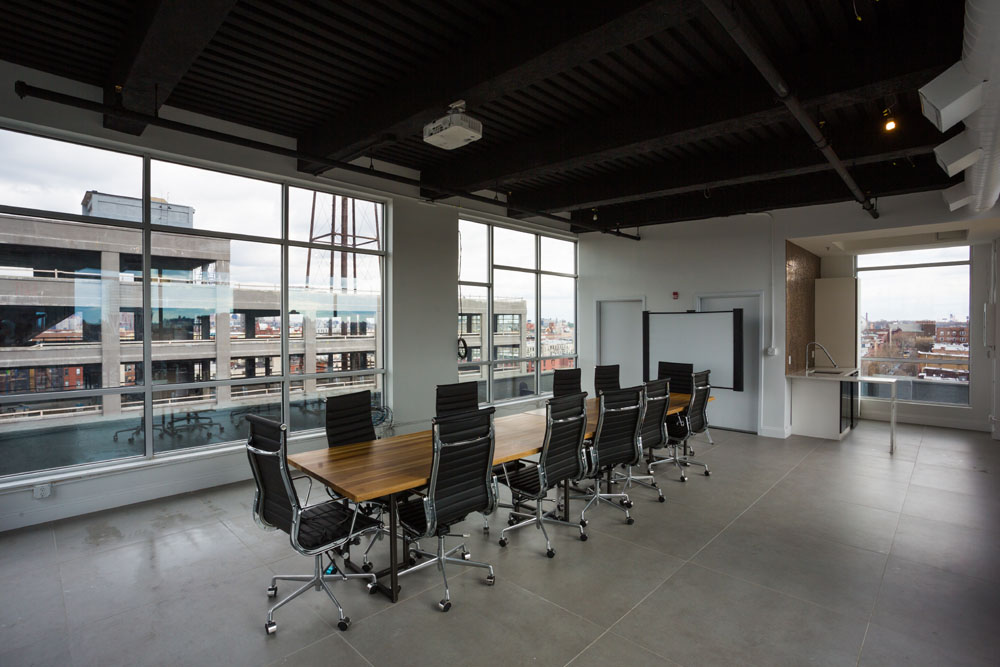 Conference room with table and office chairs
